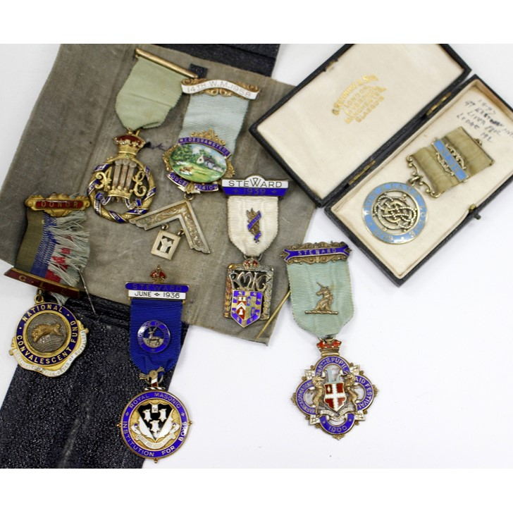 A collection of masonic medals to include a silver gilt enamelled