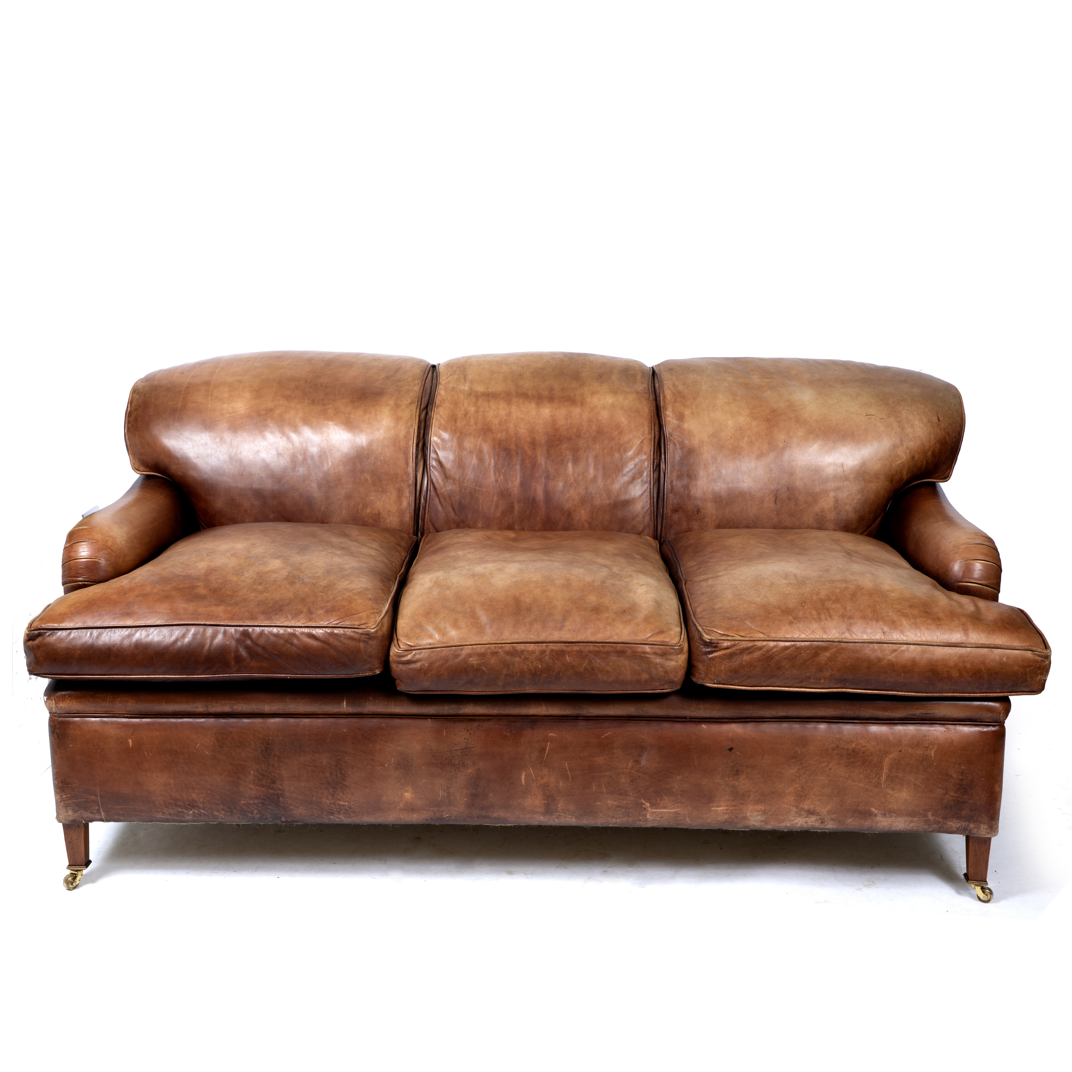 A HOWARD CHAIRS LIMITED BROWN LEATHER UPHOLSTERED THREE SEATER SOFA Image